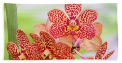 Orange Spotted Orchids Beach Towel