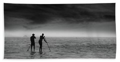 Beach Towel featuring the photograph Paddle Boarders by John Rodrigues