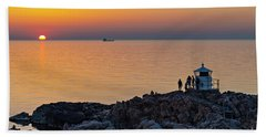 People Gathering Near Lighthouse At Sunset Beach Towel