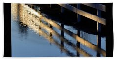 Beach Towel featuring the photograph Reflected Fence At Sunrise by Jerry Sodorff