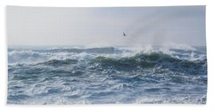 Beach Towel featuring the photograph Reynisfjara Seagull Over Crashing Waves by Nathan Bush