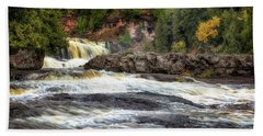 Beach Towel featuring the photograph Roaring Gooseberry Falls by Susan Rissi Tregoning