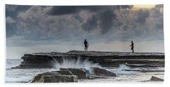 Rock Ledge, Spear Fishermen And Cloudy Seascape Beach Towel