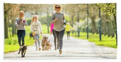 Running With Her Dog In The Park Beach Towel
