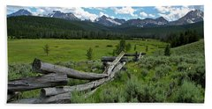 Sawtooth Range And 1975 Pole Fence Beach Towel