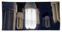 Single Light Bulb Illuminated In Collection Beach Towel