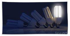 Single Light Bulb Illuminated In Row Beach Towel