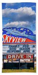 Beach Towel featuring the digital art Skyview Drive-in Theater Neon Sign by Robert FERD Frank