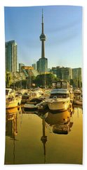 Sunrise At The Harbour Beach Towel
