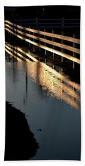 Beach Towel featuring the photograph Sunrise Fence And Reflection by Jerry Sodorff