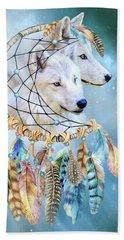 Beach Towel featuring the mixed media Wolf Dreams by Carol Cavalaris