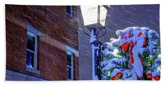 Beach Towel featuring the photograph Wreath On A Lamp Post by Jeff Sinon