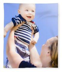 Happy Baby Held Up To The Sky Fleece Blanket