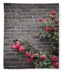 Roses On Brick Wall Fleece Blanket