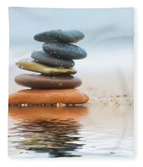 Stack Of Beach Stones On Sand Fleece Blanket