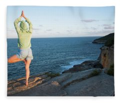 Yoga On Rocky Outcrop Above Ocean Fleece Blanket