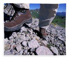 A Female Hiker Goes Up A Rocky Trail Fleece Blanket