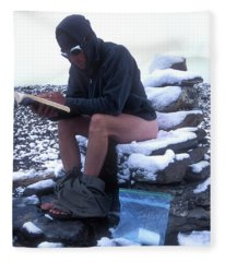 A Man Reads While Using A Snow-covered Fleece Blanket