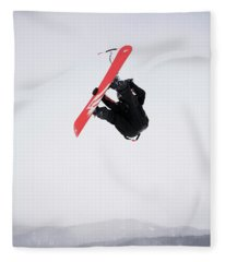A Mid Adult Man Gets Air While Snow Fleece Blanket