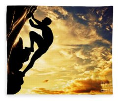 A Silhouette Of Man Free Climbing On Rock Mountain At Sunset Fleece Blanket