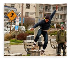 American Skateboarder In City Action Shot Fleece Blanket
