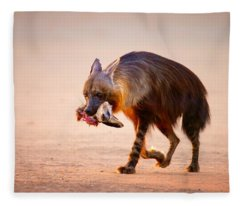 Brown Hyena With Bat-eared Fox In Jaws Fleece Blanket