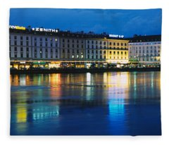 Buildings Lit Up At Night, Geneva Fleece Blanket