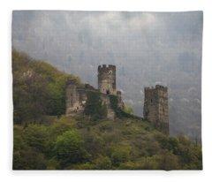 Castle In The Mountains. Fleece Blanket
