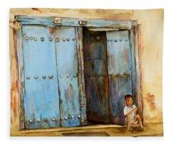 Child Sitting In Old Zanzibar Doorway Fleece Blanket
