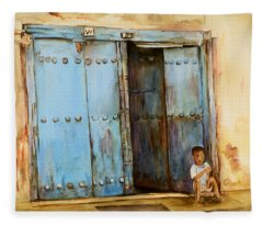 Child Sitting In Old Zanzibar Doorway Fleece Blanket