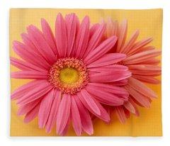 Close Up Of Two Pink Zinnias On Yellow Fleece Blanket