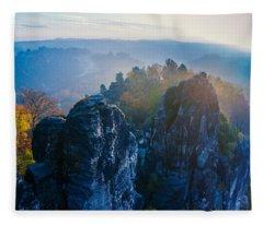 Early Morning Mist At The Bastei In The Saxon Switzerland Fleece Blanket
