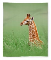 Giraffe Lying In Grass Fleece Blanket