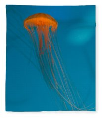 Glowing Orange Sea Nettle Fleece Blanket