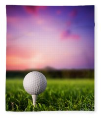 Golf Ball On Tee At Sunset Fleece Blanket