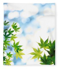 Green Leaves On Mottled Cloudy Sky Fleece Blanket
