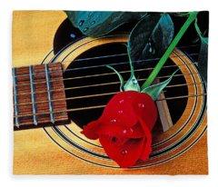 Guitar With Single Red Rose Fleece Blanket