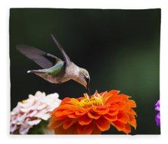 Hummingbird In Flight With Orange Zinnia Flower Fleece Blanket