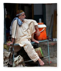 Man Sits And Relaxes In Lahore Walled City Pakistan Fleece Blanket