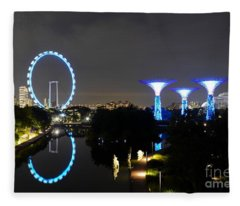 Night Shot Of Singapore Flyer Gardens By The Bay And Water Reflections Fleece Blanket