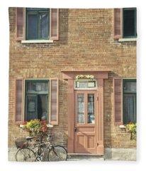 Old Downtown Building Doorway And Bike On Street Fleece Blanket