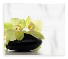 Orchid Flowers On Polished Stone Fleece Blanket