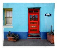 Red Door On Blue Wall Fleece Blanket