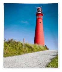 Red Lighthouse And Deep Blue Sky. Fleece Blanket
