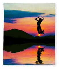 Silhouette Of Happy Woman Jumping At Sunset Fleece Blanket