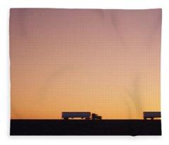 Silhouette Of Two Trucks Moving Fleece Blanket