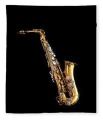 Single Saxophone Against Black Fleece Blanket