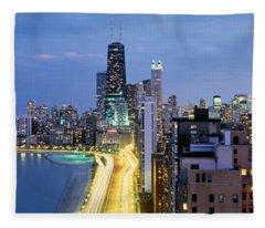 Skyscrapers Lit Up At The Waterfront Fleece Blanket