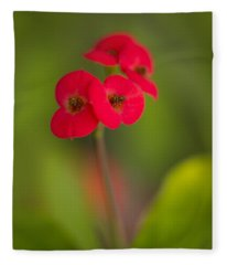 Small Red Flowers With Blurry Background Fleece Blanket