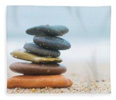 Stack Of Beach Stones On Sand Fleece Blanket
